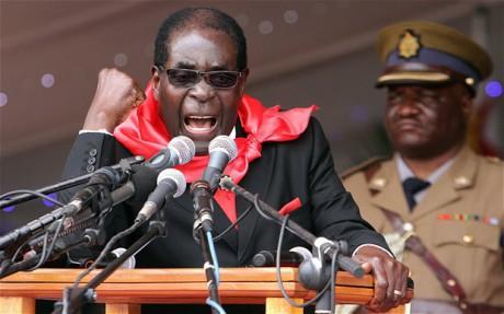 Valkoiset maanomistajat on Mugaben mukaan ajettava pois.